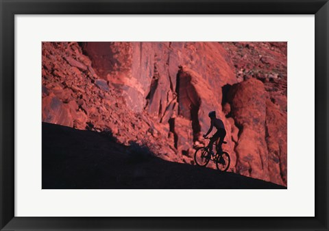 Framed Silhouette of a man mountain biking, Moab, Utah, USA Print