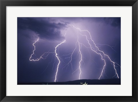 Framed Lightning bolts striking the earth Print