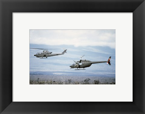 Framed left side view of an AH-1 Cobra helicopter, front, and an OH-58 Kiowa helicopter Print