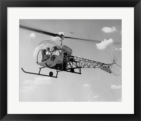 Framed Low angle view of two people sitting in a helicopter, Bell 47G-2 Print
