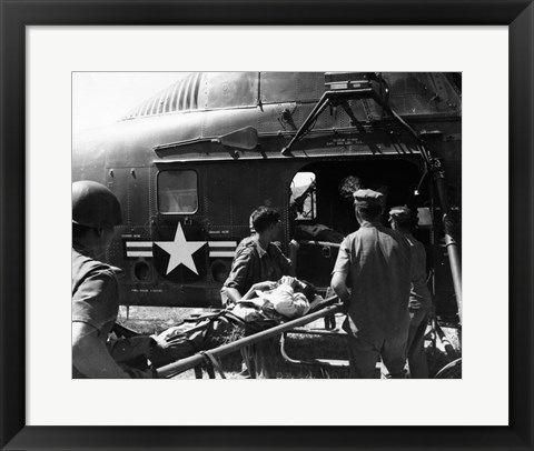 Framed Army soldiers carrying an injured person in a helicopter Print