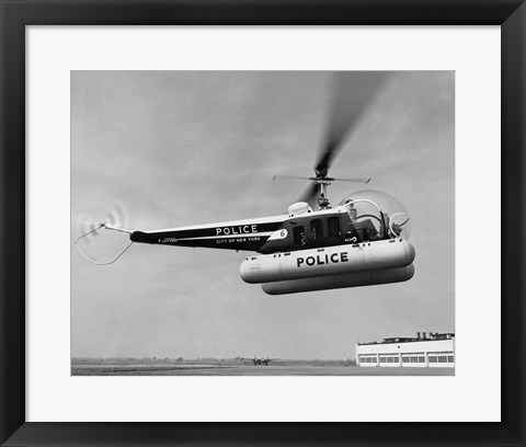 Framed Low angle view of a helicopter in flight, Bell 47-D, Bell Aircraft Corporation Print