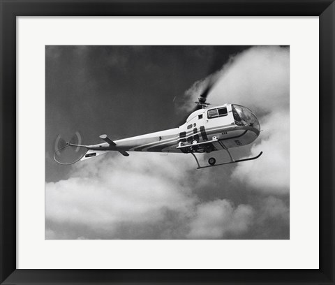Framed Low angle view of a helicopter in flight in the sky, Bell Helicopter Print