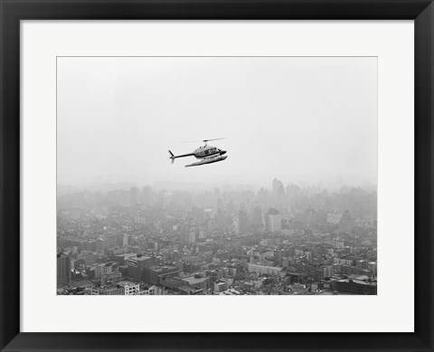 Framed USA, New York State, New York City, Helicopter over city Print
