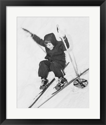 Framed Boy skiing on snow Print