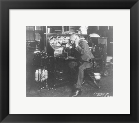 Framed Thomas Alva Edison using his dicatating machine Print
