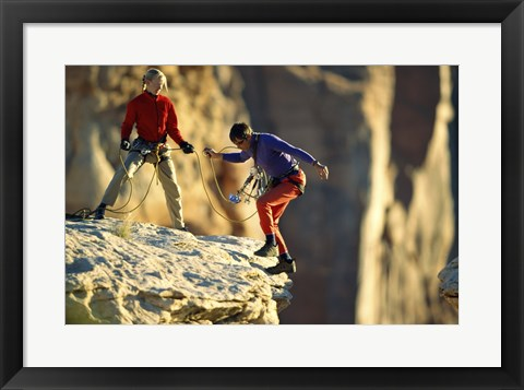 Framed Two hikers with ropes at the edge of a cliff Print