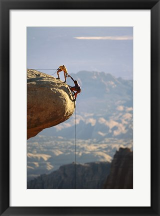 Framed Two hikers with ropes at the edge of a cliff 2 Print