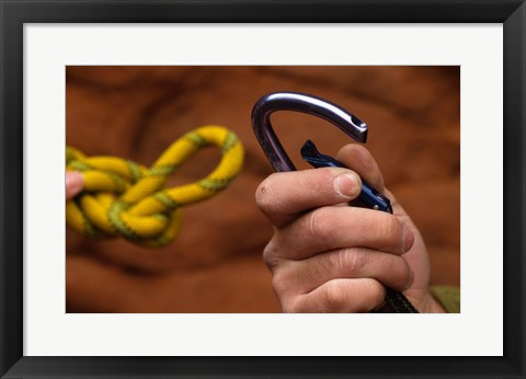 Framed Close-up of human hands holding a carabiner and rope Print