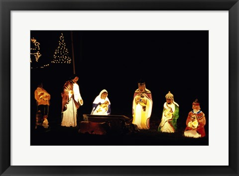 Framed Figurines depicting nativity scene lit up at night Print