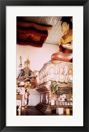 Framed Young Girl Praying in Front of a Giant Buddha Statue Print