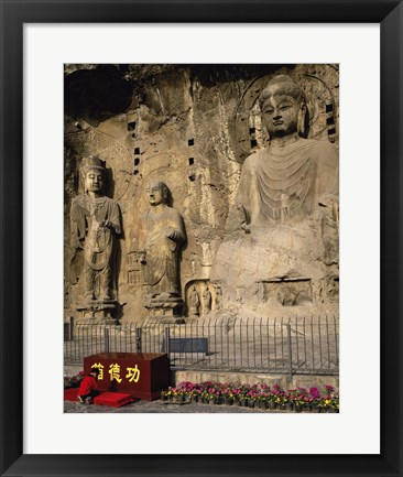 Framed Buddha Statue in a Cave, Longmen Caves, Luoyang, China with Flowers Print