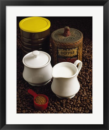 Framed Close-up of a mug of milk with a measuring spoon and jars on coffee beans Print