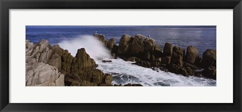 Framed Rock formations in water, Pebble Beach, California, USA Print