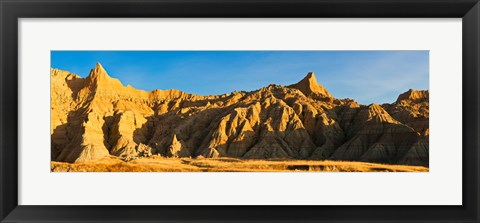 Framed Sculpted sandstone spires in golden light, Saddle Pass Trail, Badlands National Park, South Dakota, USA Print