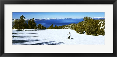 Framed Tourist skiing in a ski resort, Heavenly Mountain Resort, Lake Tahoe, California-Nevada Border, USA Print