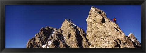 Framed Low angle view of a man climbing up a mountain, Rockchuck Peak, Grand Teton National Park, Wyoming, USA Print