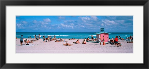 Framed Tourist on the beach, Miami, Florida, USA Print
