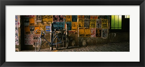 Framed Bicycle leaning against a wall with posters in an alley, Post Alley, Seattle, Washington State, USA Print