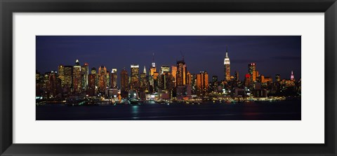 Framed Skyscrapers lit up at night in a city, Manhattan, New York City, New York State, USA Print