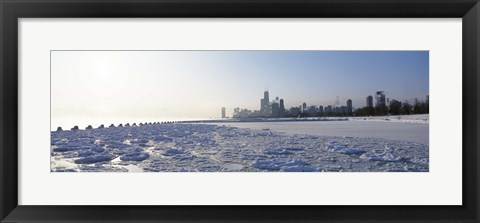 Framed Frozen lake with a city in the background, Lake Michigan, Chicago, Illinois Print