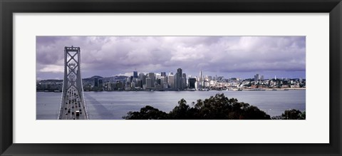 Framed Bridge across a bay with city skyline in the background, Bay Bridge, San Francisco Bay, San Francisco, California, USA Print