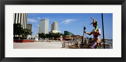 Framed Jester statue with buildings in the background, Riverwalk Area, New Orleans, Louisiana, USA Print