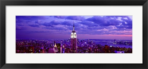Framed Empire State Building lit up in white, Midtown Manhattan, New York City Print