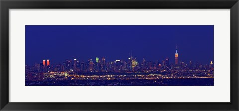 Framed Buildings in a city lit up at night, Upper Manhattan, Manhattan, New York City, New York State, USA Print