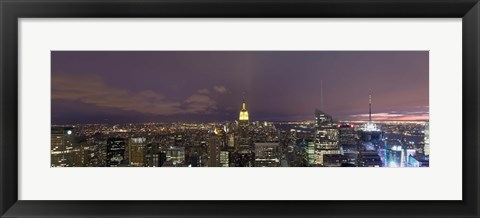 Framed Buildings in a city lit up at dusk, Midtown Manhattan, Manhattan, New York City, New York State, USA Print