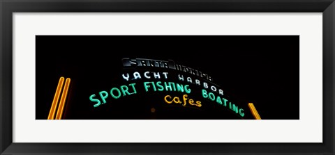Framed Low angle view of a neon signboard, Santa Monica Pier, Santa Monica, Los Angeles County, California, USA Print