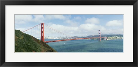 Framed Suspension bridge with a city in the background, Golden Gate Bridge, San Francisco Bay, San Francisco, California, USA Print