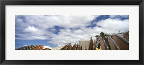Framed Low angle view of skyscrapers and surfboards, Honolulu, Oahu, Hawaii, USA Print
