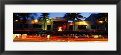 Framed Traffic in front of a building at dusk, Art Deco District, South Beach, Miami Beach, Miami-Dade County, Florida, USA Print