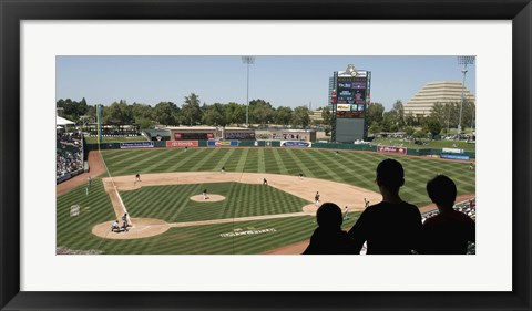 Framed Spectator watching a baseball match at stadium, Raley Field, West Sacramento, Yolo County, California, USA Print