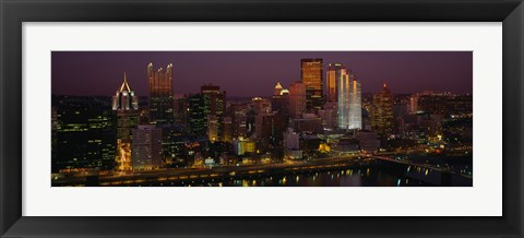 Framed High angle view of buildings lit up at night, Pittsburgh, Pennsylvania, USA Print