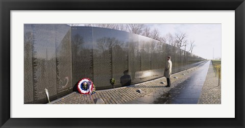 Framed Side profile of a person standing in front of a war memorial, Vietnam Veterans Memorial, Washington DC, USA Print