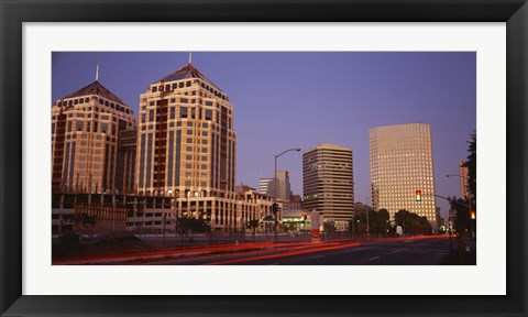 Framed USA, California, Oakland, Alameda County, New City Center, Buildings lit up at night Print