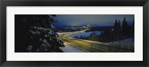 Framed Winding road running through a snow covered landscape, Anchorage, Alaska, USA Print