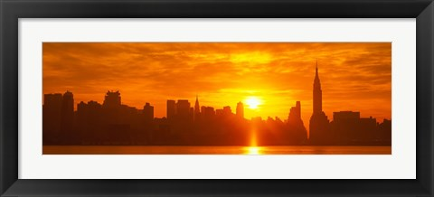 Framed Birght Orange Sky and Sun Behind the New York City Skyline Print