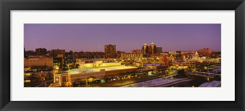Framed High angle view of buildings lit up at dusk, Kansas City, Missouri, USA Print