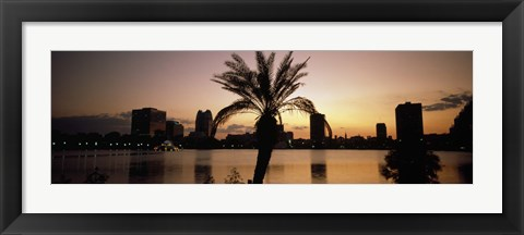 Framed Silhouette of buildings at the waterfront, Lake Eola, Summerlin Park, Orlando, Orange County, Florida, USA Print