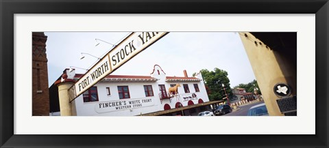 Framed Low angle view of a commercial signboard, Fort Worth Stockyards, Fort Worth, Texas, USA Print