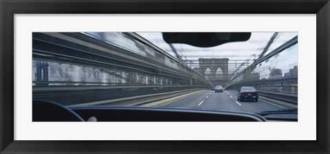 Framed Cars moving on the bridge, Brooklyn Bridge, New York City, New York State, USA Print