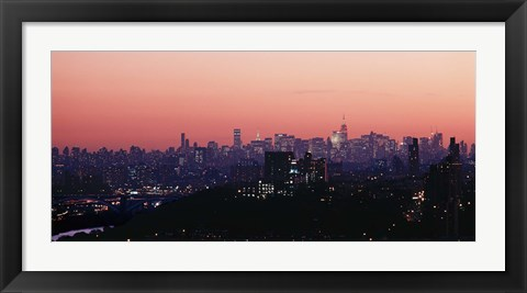 Framed High angle view of buildings lit up at dusk, Manhattan, New York City, New York State, USA Print