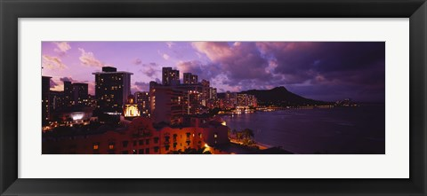Framed Buildings lit up at dusk, Waikiki, Oahu, Hawaii, USA Print