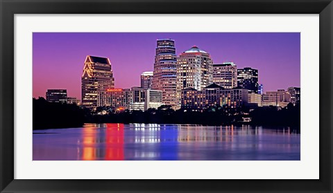Framed USA, Texas, Austin, View of an urban skyline at night Print
