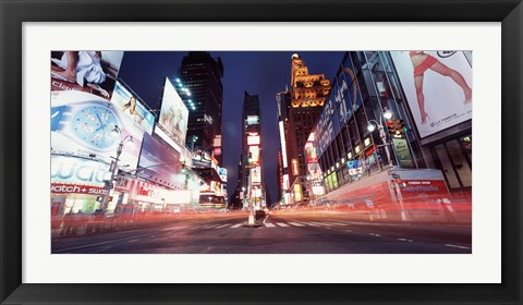 Framed Low angle view of sign boards lit up at night, Times Square, New York City, New York, USA Print