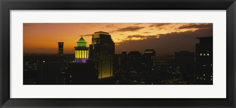 Framed High angle view of buildings lit up at dusk, New Orleans, Louisiana, USA Print