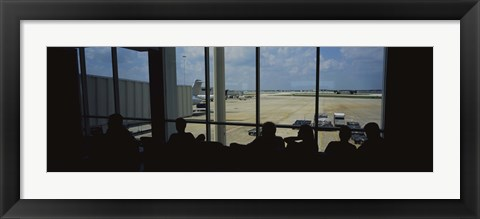 Framed Silhouette of a group of people at an airport lounge, Orlando International Airport, Orlando, Florida, USA Print